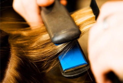 thinkstock_rf_photo_of_flat_iron_pressing_hair